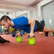 Crossfit fitness man push ups Kettlebells pushup exercise — Stock Photo