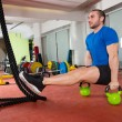 Crossfit fitness man L-sits Kettlebells L sits exercise - Stock Photo