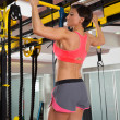 Crossfit fitness toes to bar man pull-ups 2 bars with TRX — Stock Photo