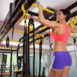 Crossfit fitness toes to bar man pull-ups 2 bars with TRX — Stock Photo #25465073