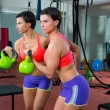 Crossfit fitness lifting Kettlebell woman at mirror workout - Stock Photo