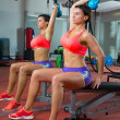 Crossfit fitness weight lifting Kettlebell woman at mirror - Stock Photo