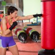 Crossfit woman boxing with red punching bag — Stock Photo #25466067