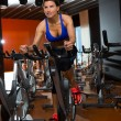 Aerobics spinning woman exercise workout at gym — Stockfoto