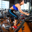 Aerobics spinning woman exercise workout at gym — Stock Photo
