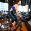 Aerobics spinning woman exercise workout at gym — Stok fotoğraf