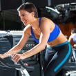 Aerobics spinning monitor trainer woman at gym - Stock Photo