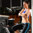 Aerobics spinning monitor trainer woman stretching — Stockfoto
