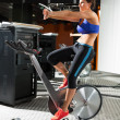 Aerobics spinning monitor trainer woman stretching — Foto de Stock