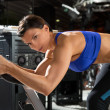 Aerobics spinning monitor trainer woman at gym — Foto de Stock