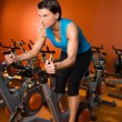 Foto Stock: Aerobics spinning woman exercise workout at gym