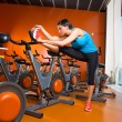 Aerobics spinning woman stretching exercises after workout — ストック写真