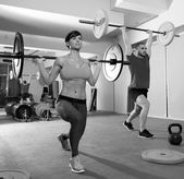 Crossfit fitness gym weight lifting bar group — Stock Photo
