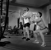 Crossfit ball fitness workout group woman and man — Stockfoto