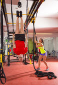 Crossfit fitness dip ring man workout upside down at gym — Stock Photo