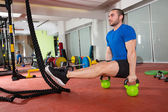 Crossfit fitness man L-sits Kettlebells L sits exercise — Stock Photo