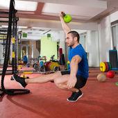 Crossfit fitness man balance Kettlebells with one leg — Zdjęcie stockowe