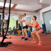 Crossfit ball fitness workout group woman and man — Stock Photo