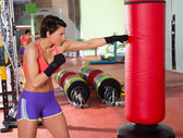 Crossfit woman boxing with red punching bag — Stock Photo