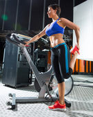 Aerobics spinning monitor trainer woman stretching — Stock Photo