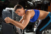 Aerobics spinning monitor trainer woman at gym — Stock Photo