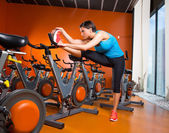 Aerobics spinning woman stretching exercises after workout — Stock Photo