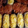 Barbecue grilled beef meat and prepared potatoes — Stock Photo