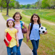 Children kid girls walking to schoool with sport balls — 图库照片