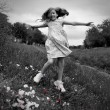 Happy children girl jumping on spring poppy flowers — Stock Photo #26175697