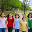 Children group of sisters girls and friends walking in park — Stock Photo #26176075