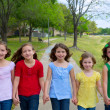 Stock Photo: Children group of sisters girls and friends walking in park