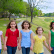 Children group of sisters girls and friends walking in park — Stock Photo