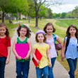 children kid girls walking to schoool with sport balls — Stock Photo
