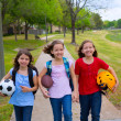 Foto de Stock  : Children kid girls walking to schoool with sport balls