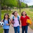 Foto Stock: Children kid girls walking to schoool with sport balls