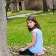 Beautiful kid girl smiling sitting on park lawn relaxed — Stock Photo