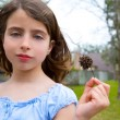 Girl portrait with sweetgum spiked fruit on park — Stock Photo