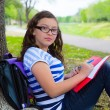 Clever student teen girl with school bag under park tree — Stock Photo