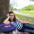 Clever student teen girl with school bag under park tree — Stock Photo #26178567