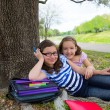 Sister firends girls relaxed under tree park after school — Lizenzfreies Foto