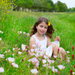 Children cute girl on spring meadow with poppy flowers — Stock Photo