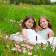 Children friends girls on spring poppy flowers meadow — Stock Photo #26179151