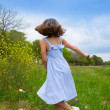 Happy children girl jumping on spring poppy flowers — Stock Photo #26179291