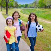 Children kid girls walking to schoool with sport balls — Stock Photo