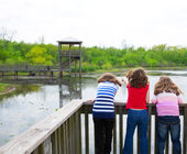 Girls looking at park lake in Texas — Stock Photo