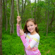 Happy girl playing in forest park jungle with liana — Stock Photo #26180339
