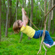 Girls playing hanging in lianas at jungle park — Stock Photo #26180563
