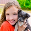 Beautiful kid girl portrait with puppy chihuahua doggy — Foto de Stock
