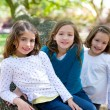 Friend sister girls resting on tree trunk nature — Stock Photo #26180841