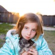 Blond children kid girl playing with puppy dog chihuahua — Stock Photo #26180941